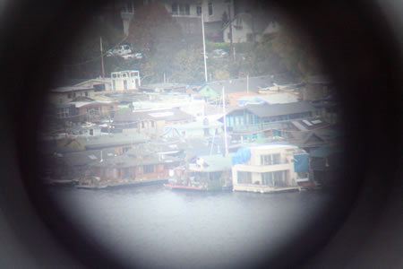Houses by water through telescope
